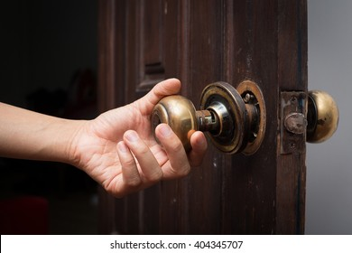 Broken door knob on wooden door