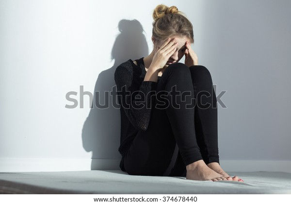 Broken down young lonely girl with depression
