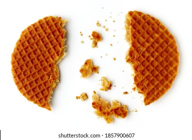 Broken Dutch stroopwafel with caramel and honey isolated on white background, top view