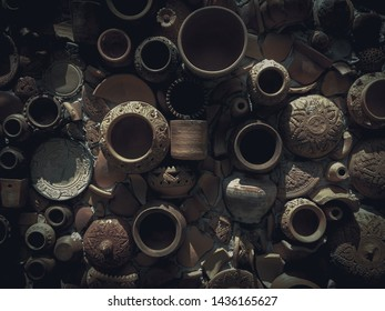 Broken earthenware on ancient wall background. Traditional Earthenware with retro style.