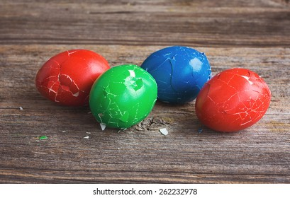 Broken Easter eggs on wooden background