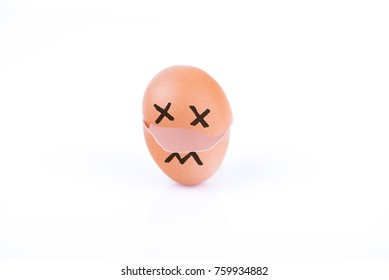 Broken egg with face on a white background