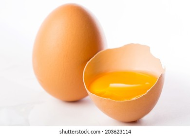 Broken egg isolated placed on the white background
