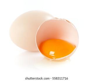 Broken egg over white