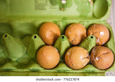 Broken Eggs with Cracked Egg Shell in Green Egg Carton Container concept for Easter Egg, Failure, Transportation, Pakaging, Fragile, Protection, Breakfast, Domestic Violence, Stress or Careless Person