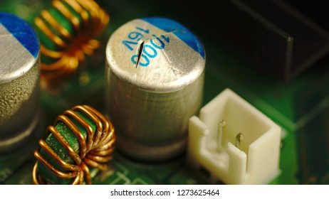 A broken electrolytic capacitor on the motherboard