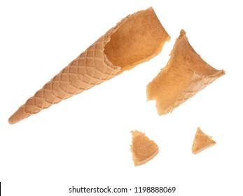 Broken empty sugar ice cream cone in pieces isolated on white background.