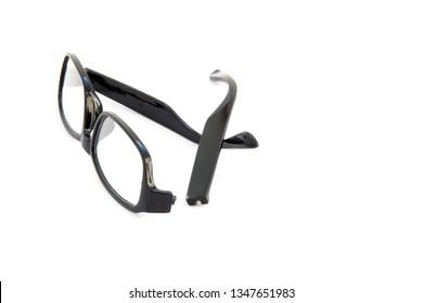 Broken eye glasses, isolated on white background. Black celluloid frame.