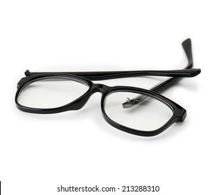 Broken eye glasses, isolated on white. Black plastic frame