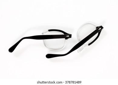 Broken eye glasses, isolated on white