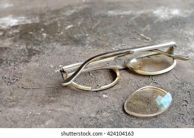Broken eyeglasses. Selective focus on damage.
