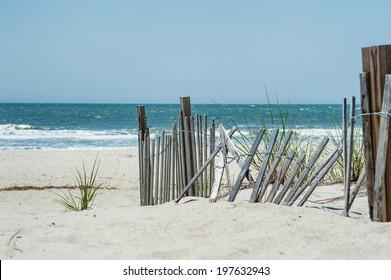 Broken fence on a beach near the ocean