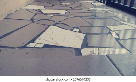 Broken floor tiles with beautiful patterns