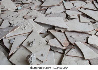 Broken floor tiles in the house.