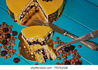 broken with a fork a piece of blueberry cake