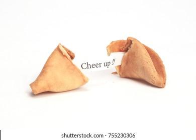 Broken fortune cookie with Cheer Up! fortune