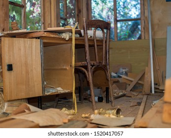 Broken furniture in a messy room, interior of seemingly abandoned house