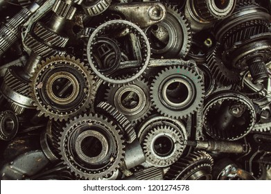 A lot of broken gears and shafts in the garbage box