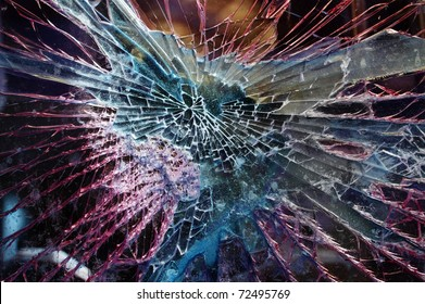 Broken glass with colorful background
