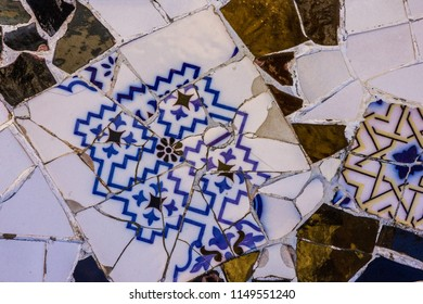 Broken glass mosaic tile, decoration in Park Guell, Barcelona, Spain. Designed by Gaudi