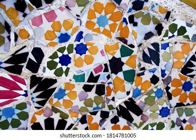Broken glass mosaic tile, decoration in the Park Guell, Barcelona, Spain.Pottery art Gaudi