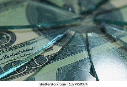 broken glass on the background of a money bill.  hundred dollar bill. the concept of inflation and the financial crisis.