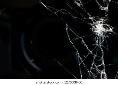 broken glass on dark background, crack in right corner