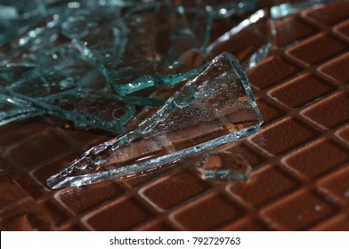 Broken glass on the floor. The glass was smashed. Broken glass background.