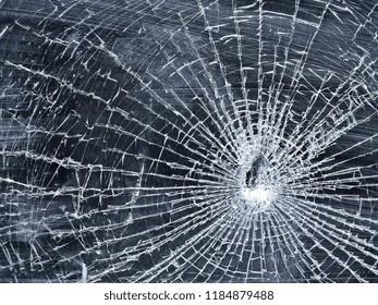 Broken glass on grey background