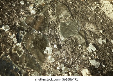 broken glass on the ground,background,abstract,outside,bits and pieces,rocks,slides,