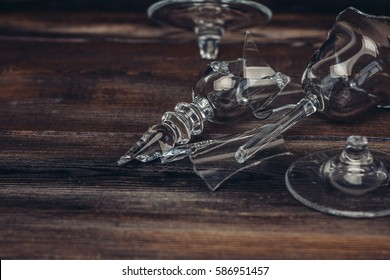 broken glass on a wooden background.