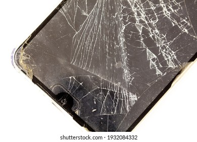 Broken glass of the phone on a white background. Close-up