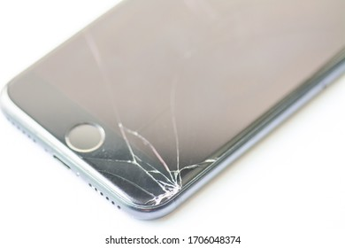 Broken glass screen smartphone on white background.