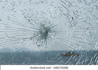 Broken glass with sea on background.