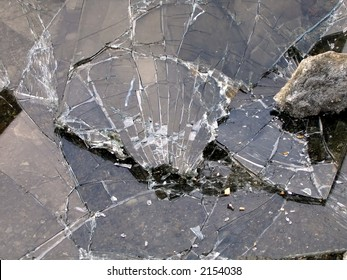 Broken Glass -- a smashed window and a rock