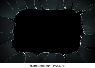 Broken glass with space for text on black background