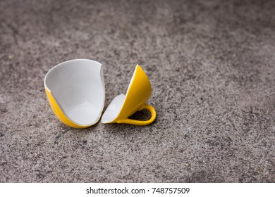 Broken glass of tea Down on the ground.