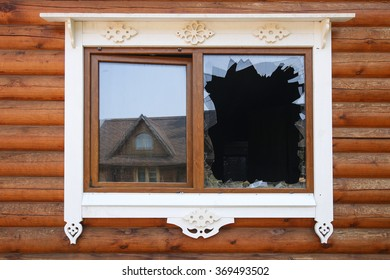 broken glass window with reflecting  in a wooden house