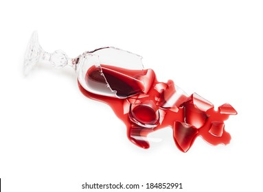 Broken glass of wine. Poured red wine, like blood. Isolated on white background. Studio shoot.