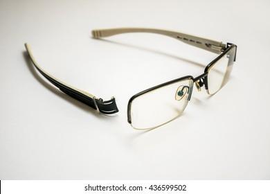 broken glasses black one leg