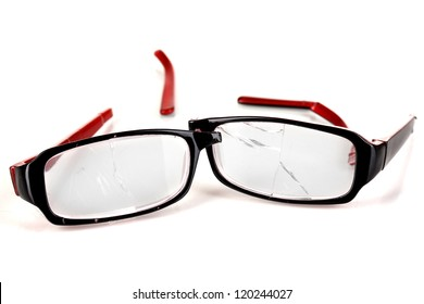 Broken glasses isolated on white