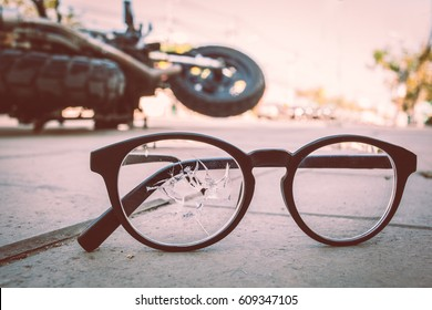 Broken glasses with motorcycle accident on the city street