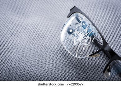 broken glasses on a metal background. concept of failure in business