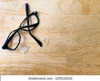 Broken glasses on table