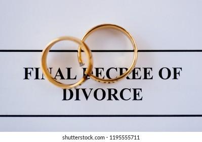 Broken golden wedding rings divorce decree document. Divorce and separation concept
