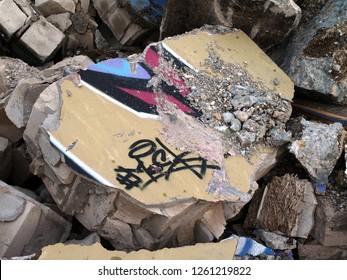Broken graffitis at a deconstruction site