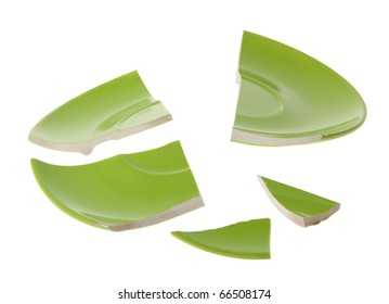 Broken green plate on white background