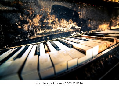 Broken grunge old piano keys close up. Musical instrument in an advanced state of degradation. Vintage look