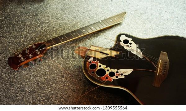 Broken, broken guitar