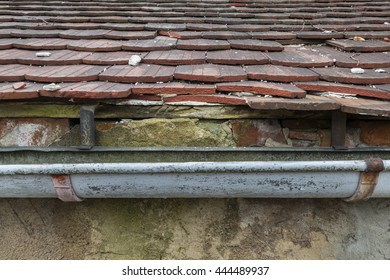 broken guttering on the roof of a house